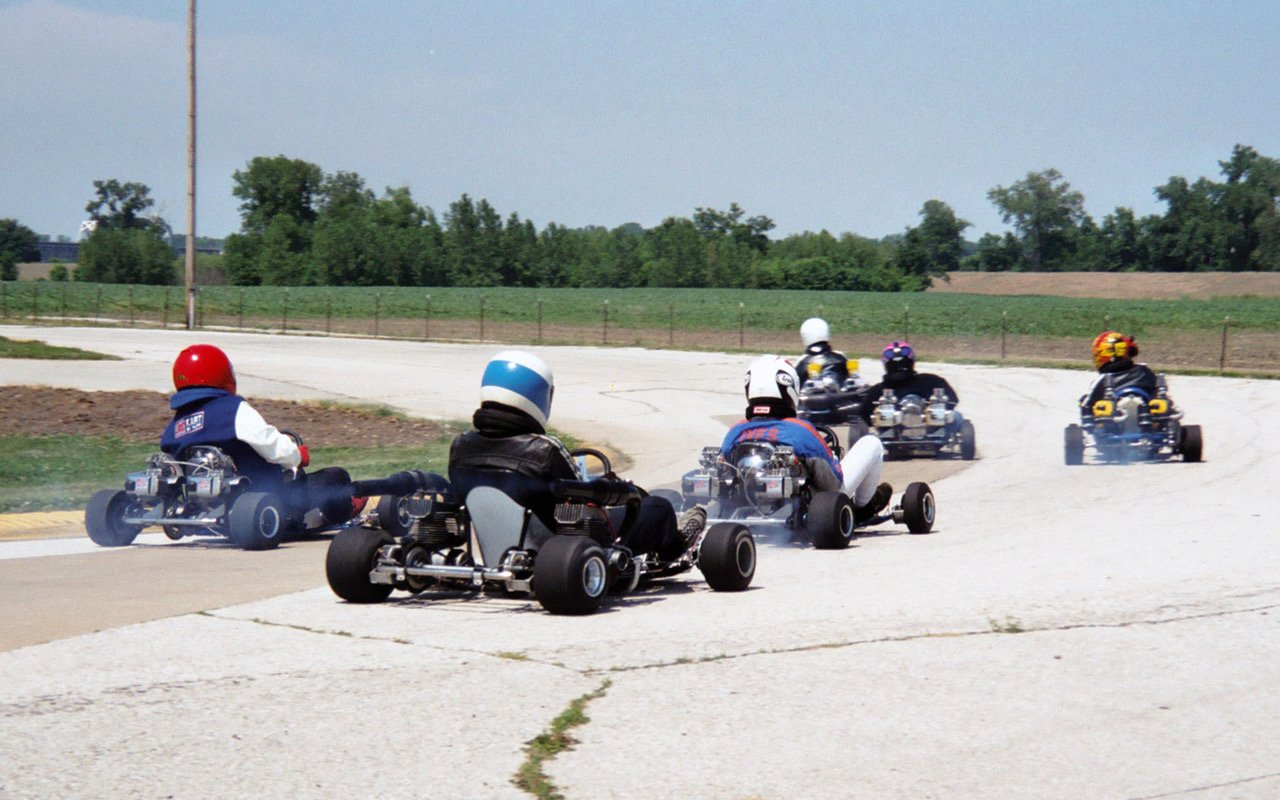 Here a group of twins (rear engined and sidewinders) take to Quincy's expansive racing surface