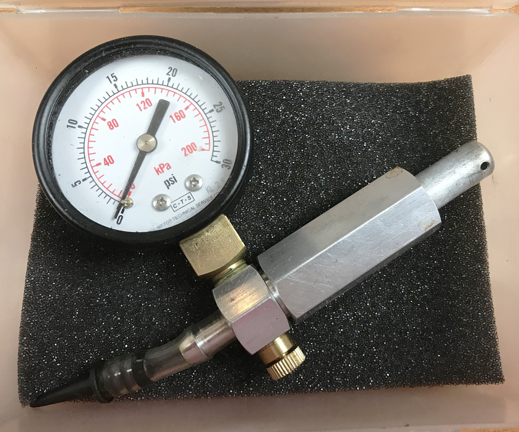 Get a good pressure check gauge. If you run 2-strokes, you'll need it often. I found this one on the internet for about $35.