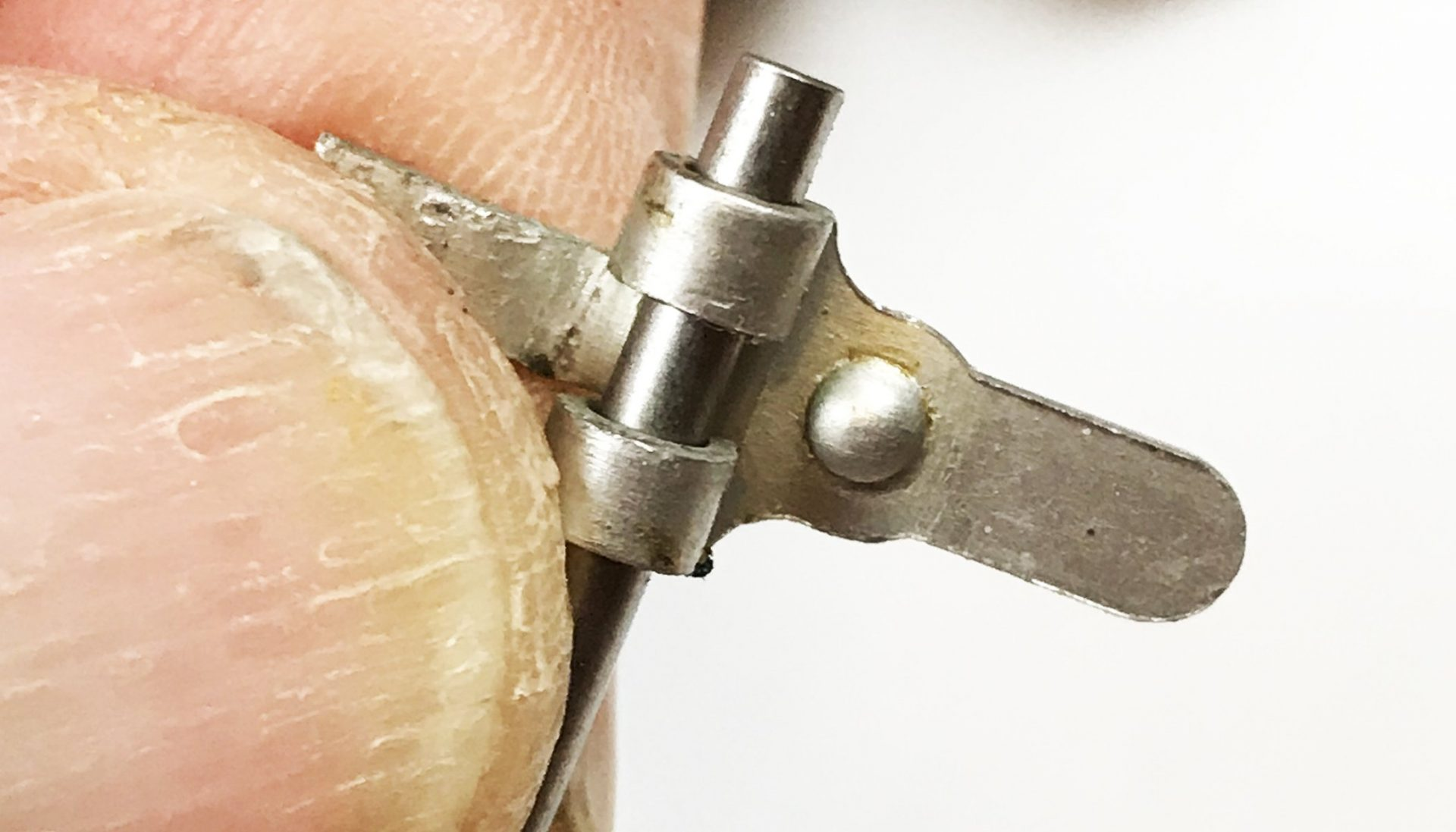 The stamped steel fulcrum lever is pretty fragile, so if you need to bend it to adjust fulcrum lever height (described further on), be gentle. The bottom side has a dome that helps retain the spring. Make sure the fulcrum lever rotates freely on the axle.