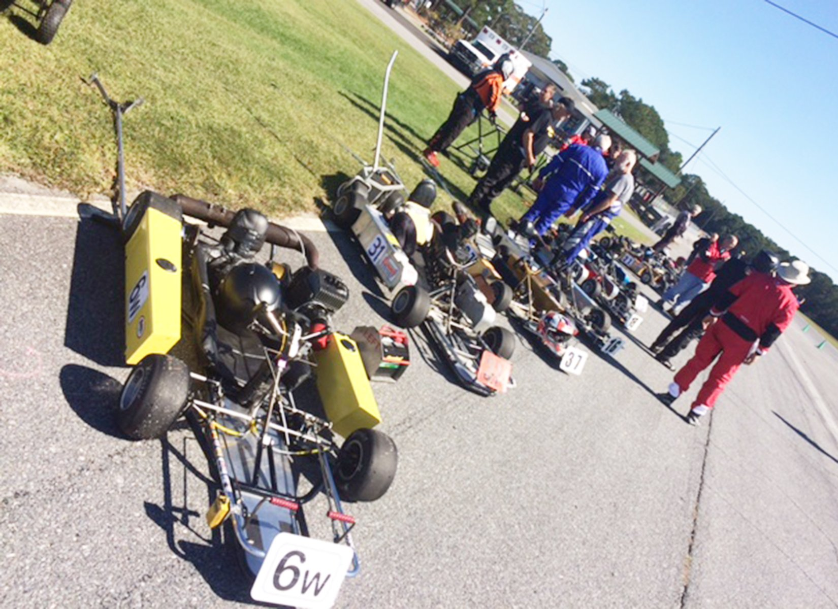 Arthur McKenny's kart (#6w) at the head of the starting grid