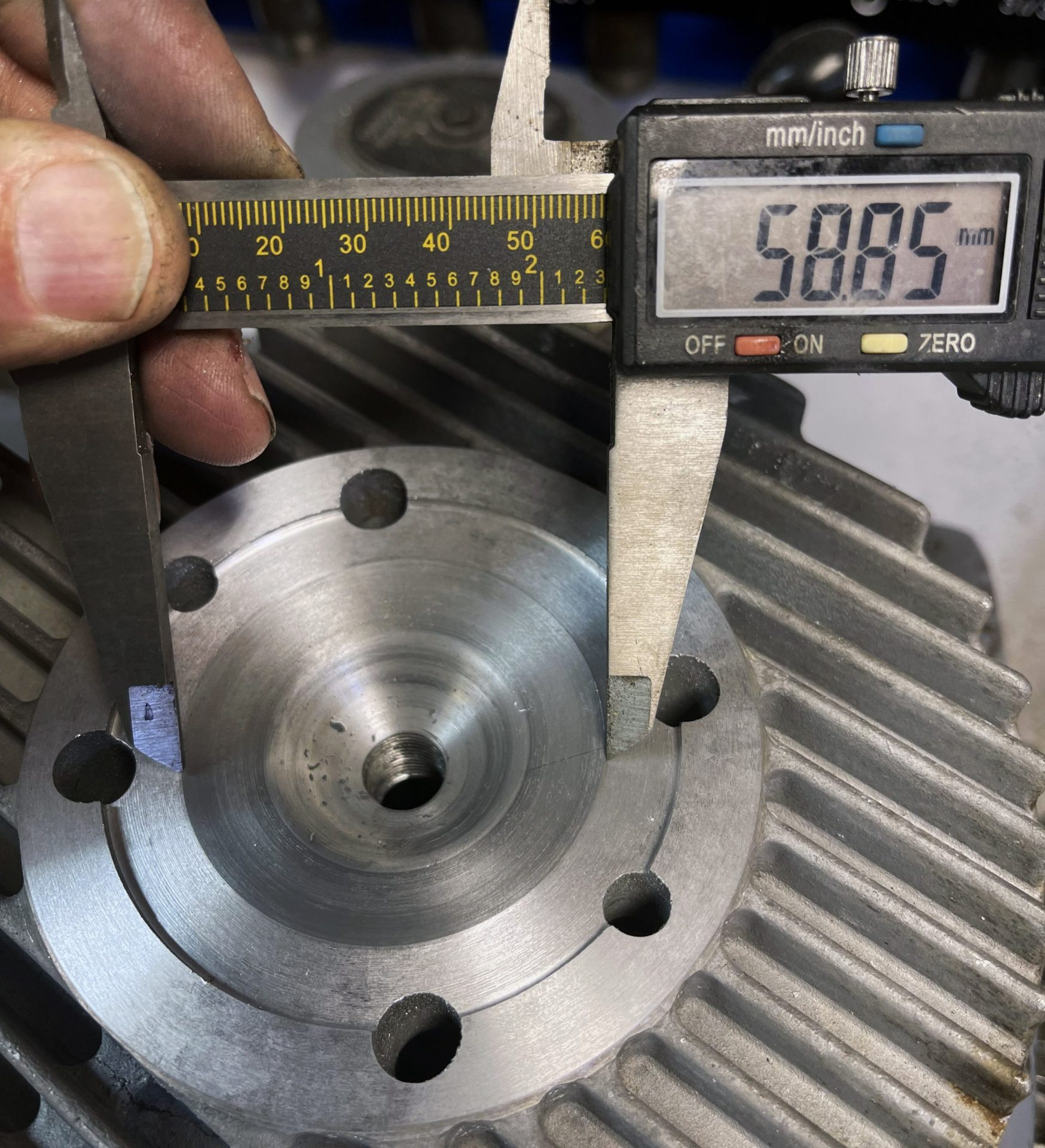 The final check is to make sure the squish band is the correct diameter for your engine's bore. We are using a 58.8mm piston, so the 58.85mm size is just about right. If your diameter is too small, cut the squish band deeper. If it is too big, cut the cylinder sealing surface some more. After you do a couple of these you'll get the hang of juggling the dimensions for the desired results.