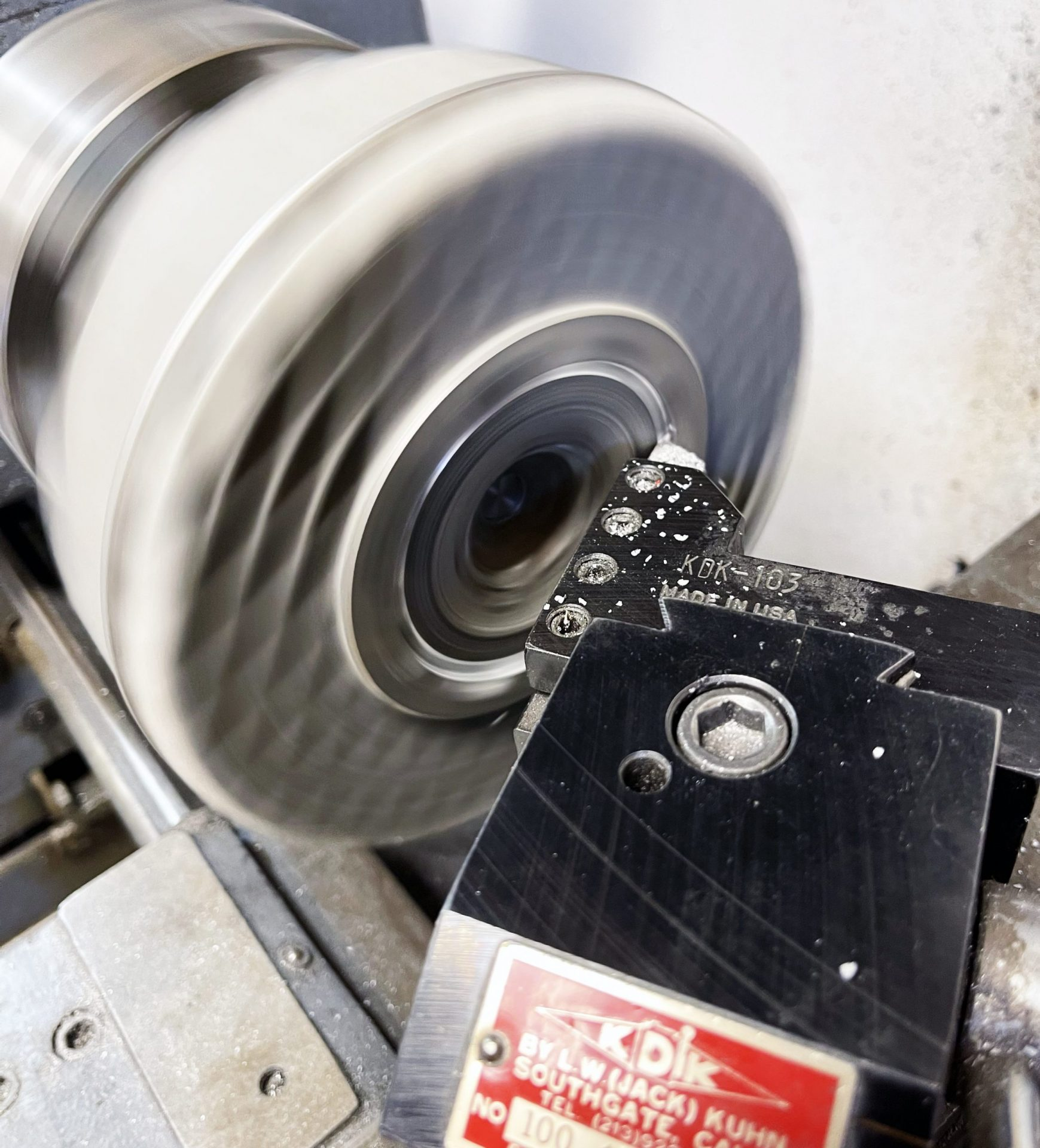 """We first machined the head-to-barrel sealing surface. To do this we ran the lathe in reverse (clockwise) so that we could easily see the cutting tool. Important because the tool must cut all the way into the corner of the """"step"""" for the liner. The cylinder must be very tight on the mandrel or it will unscrew from the force of the cutting tool."""